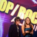 Richie Sambora and Colbie Caillat onstage during the 2008 American Music Awards on November 23, 2008 in Los Angeles, CA