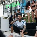 Tyga performs during DAYLIGHT Beach Club's grand opening weekend at the Mandalay Bay Resort and Casino on March 26, 2017 in Las Vegas, Nevada - 454 x 368