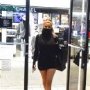 Larsa Pippen – In a mini black dress out for a shopping