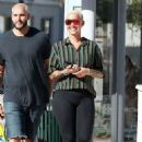 Amber Rose in Black Leggings – Out in Miami - 454 x 692