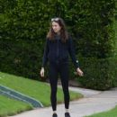 Troian Bellisario – Out for a walk with her dog in Los Angeles - 454 x 546