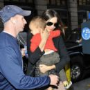 Model Miranda Kerr carries baby Flynn Bloom as she makes her way home in New York City.03/14/12