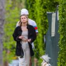 Olivia Holt – Walks her dog with a mystery friend in Los Angeles