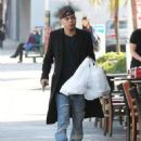 Evan Ross stops to pick up some lunch to go in Sherman Oaks, California on December 19, 2014