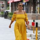 Vogue Williams – Wearing a yellow dress while arriving at Global Radio in London