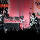 Musicians Gene Simmons, Tommy Thayer and Eric Singer of KISS perform onstage during the 23rd Annual Race To Erase MS Gala at The Beverly Hilton Hotel on April 15, 2016 in Beverly Hills, California - 454 x 310