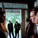 Jennifer Coolidge as Genevieve talk with Nicolas Cage as Terence and Eva Mendes as Frankie in Bad Lieutenant: Port of Call New Orleans.