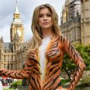 Joanna Krupa – Bodypaint while protesting outside Westminster in London - 454 x 649