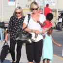 Charlize Theron- at a Cretan airport with her kids August 2016 - 454 x 609
