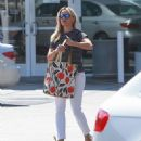 Actress and busy mom Reese Witherspoon is spotted at the Brentwood Country Mart on July 28, 2015 in Brentwood, California