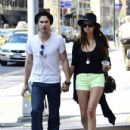 Nina Dobrev enjoyed an afternoon walk with her man, Ian Somerhalder today in New York City. The couple wore matching hats as they strolled hand in hand through the streets