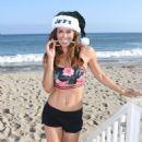 Brooke Burke in Shorts on the beach for Christmas Eve in Malibu - 454 x 681