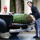 The Switched at Birth actor had help from his daughter, Julianna, picking up his tree at Notre Dame High School in L.A. on Dec. 8, 2013 - 454 x 376