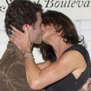 GET A ROOM! Janice Dickinson and porn star James Deen have a make out session in front of Chateau Marmont