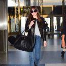 Dakota Johnson – Seen at the airport in Los Angeles