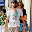 Leonardo DiCaprio's girlfriend Toni Garrn plants a kiss on his cheek while they walk through the busy streets together on Wednesday (September 3) in New York City