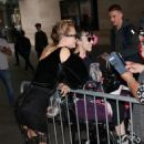 Cara Delevingne looks elegant in black dress as she greets fans at the BBC Studios in London