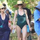 Anne Vyalitsyna in Green Swimsuit on the beach in Miami