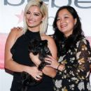 Bebe Rexha – The new face of Bebe poses during an appearance in New York