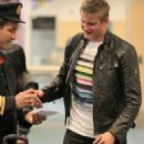 Alexander Ludwig greets some fans after landing at Vancouver International Airpor