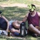 Jennifer Lawrence and Nicholas Hoult were spotted walking hand in hand and cuddling at La Fontaine Park in Montreal yesterday, August 20