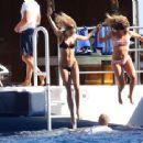 Kimberley Garner in Black Bikini on a yacht in Italy - 454 x 339