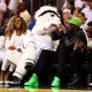 Tennis player Serena Williams (L) and runner Usain Bolt (R) attend Game Four of the 2014 NBA Finals between the Miami Heat and the San Antonio Spurs at American Airlines Arena on June 12, 2014 in Miami, Florida. NOTE TO USER: User expressly acknowledges a - 454 x 333