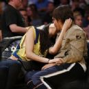 That's one Red Hot smooch! Anthony Kiedis, 52, shares passionate courtside kiss with Brazilian model Wanessa Milhomem, 22, at the LA Lakers game - 454 x 335