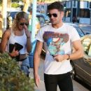 Zac Efron and Sami Miro are seen leaving Sam's modeling agency, DT Model Management, in West Hollywood, California on November 5, 2014