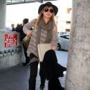 Elsa Pataky Departs LAX With Chris Hemsworth
