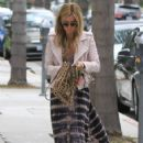 Ashley Tisdale stops by an office building in Beverly Hills, California on April 18, 2014