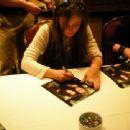 Katie signing autographs - 454 x 340