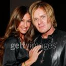 Billy Duffy and AJ Celi attend the Chanel Botique Opening in Beverly Hills