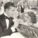 Dick Powell and Dorothy Dare in