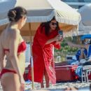 Liv Tyler – Seen at the beach with family in Miami Beach