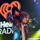 Recording artist Steve Stevens performs onstage during the first ever iHeart80s Party at The Forum on February 20, 2016 in Inglewood, California. - 454 x 302