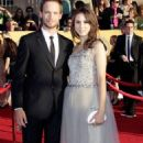 Patrick J. Adams and Troian Bellisario - 454 x 795