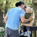 Proud parents Fergie and Josh Duhamel stop to hug after picking up their baby boy Axl from a baby class in Santa Monica, California on November 6, 2014