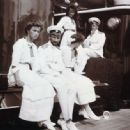 This photograph of Grand Duchess Olga Nikolaevna of Russia, Pavel Voronov, Grand Duchesses Tatiana and Anastasia Nikolaevna of Russia and another officer in 1911 - 454 x 334