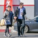 Milla Jovovich and Paul Anderson – Leaving the gym in Los Angeles - 454 x 303