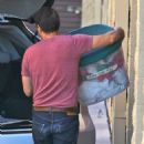 Olivier Martinez picking up Christmas ornaments from a storage locker in Los Angeles, California on November 30, 2013