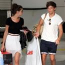 Louis Tomlinson and girlfriend, Eleanor Calder at Nice, France Airport (July 10)