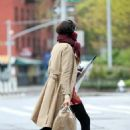 Famke Janssen – Wears her scarf as a mask while returning home in New York