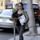 Michelle Rodriguez in Ripped Jeans Out Shopping in Beverly Hills - 454 x 619