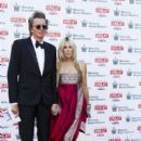 John Taylor and Gela Nash Taylor attend the Kensington Palace Summer Gala at Kensington Palace on July 9, 2015 in London, England.
