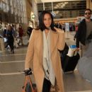 Olivia Munn: at LAX Airport in Los Angeles