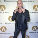 Dee Snider of the band Twsited Sister arrives at the GRAMMYs on The Hill Dinner at The Hamilton on April 13, 2016 in Washington, DC - 379 x 600