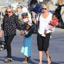 Charlize Theron- at a Cretan airport with her kids August 2016 - 454 x 381