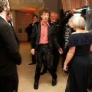 Mick Jagger and L'Wren Scott arrive at the Vanity Fair Oscar party hosted by Graydon Carter held at Sunset Tower on February 27, 2011 in West Hollywood, California - 454 x 345