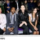 Kanye West, L'Wren Scott, Zoe and Lenny Kravitz attend the Yves Saint Laurent Fashion Show Spring/Summer 2007, on October 5, 2006 in Paris, France - 454 x 350